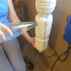 מלאו מים בבקבוק המאגר עד לגובה פתח המילוי